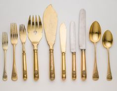 A FABERGÉ GILDED SILVER FLATWARE SERVICE, MOSCOW, CIRCA 1910 the handles with Imperial double-headed eagles,