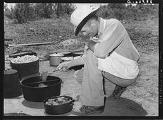 Cook of the SMS Ranch frying meat at chuck wagon on ranch near Spur, Texas. Photographer: Russel Lee, Date: May 1939 | Part of: Farm Security Administration - Office of War Information Photograph Collection (Library of Congress)