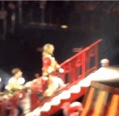This is the guy rushing to catch up to Taylor Swift while she was singing on stage during her Red tour in London