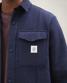 The Peter jacket offers a figure-hugging yet slightly boxy fit made from smooth navy quilted canvas, featuring front chest pockets and similar toned buttons that are all tied together for an oversized look with a small Nanushka emblem in the front. Navy Quilt, Women Wear, Men Sweater, Smooth, Buttons, Pockets, Canvas, Fitness, Model