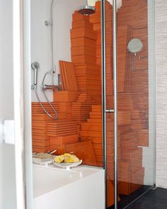 Martha Stewart's Editorial Director of Decorating, Kevin Sharkey, has his collection of Hermès boxes temporarily stored in the shower
