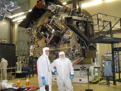Juno spacecraft is being prepped for Jupiter at Lockheed Martin Space Systems. Bunny-suited Jack Farmerie, Lockheed Martin's lead spacecraft technician on the Juno project (left) and SPACE.com reporter Leonard David.