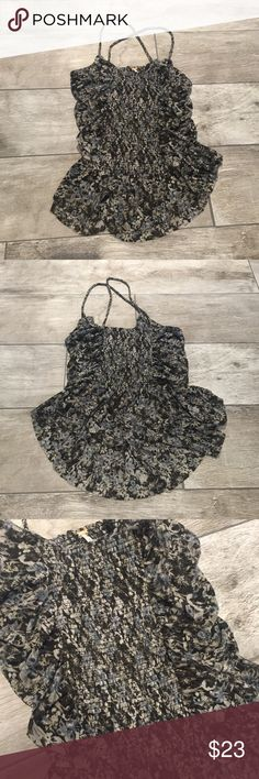 Free People tank Tight tank with flowy bottom. Criss- cross braided straps and flower pattern Free People Tops Tank Tops