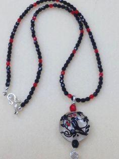 Raven necklace by poshandplayful on Etsy, $42.00