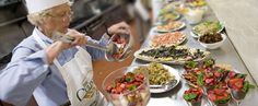 The prepared food is laid out in Instructor Veronica Arcoraci's The Joy of Healthy Cuisine, a hands-on cooking class.