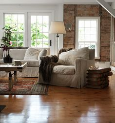 Classic American interior nicely mixed with Scandinavian details - love the stacked books used as an end table.