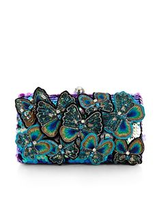 Our Belle box clutch is adorned with lavish butterflies decorated with crystal gems, sequins and multi-coloured threads. Finished with silver-tone edges, this design makes the perfect companion to the little black dress.