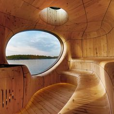 Inside this angular burnt-timber sauna by Canadian studio Partisans a cavernous cedar interior emulates the form of a seaside grotto. Dezeen Architecture, German Architecture, Scandinavian Saunas, Building A Sauna, Sunken Hot Tub, Floating Platform, Recycled Glass Bottles, Lake Huron, Global Art