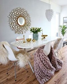 Bare chairs are boring. Style your chairs with faux fur, throw pillows and blankets