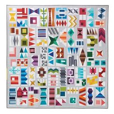 #tbt Patchwork City quilt made with 75 different #konacotton solids. I used a piece of the Silver background fabric in each block to break down the visible block structure and add movement to the composition. Love this one!