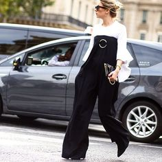 Take your cue from #PFW and layer #StellaMcCartney's strapless jumpsuit over a white top for a fashion-forward update. #Shop the look now at #NETAPORTER #SeeitLoveitBuyit #streetstyle by theurbanspotter