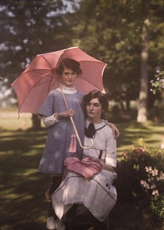 This one of Iris and Janet Laing is more true to the color of autochromes, not as bright as some.  1910's England