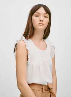 A sweet and feminine top with some ladylike ruffles