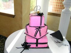 Hot Pink and Black Wedding Cake....I like that it's off center, makes it more unique!