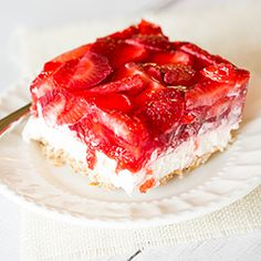 Strawberry Pretzel Salad is a taste of nostalgia! Not a salad at all, this dessert has a pretzel crust, sweet cream cheese filling and strawberry Jello topping.