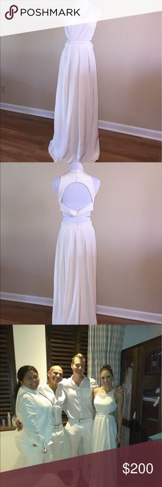 Beautiful BCBG dress that impresses. This halter cut dress looks amazing on. It was shortened to fit a 5'4 girl with high heels. Worn only once and it was a hit. BCBG Dresses Maxi