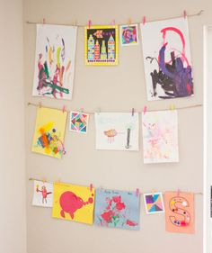 This is one of the easiest and least expensive ways to stylishly display your kid's artwork. All you need is twine, clothespins, and some nails.