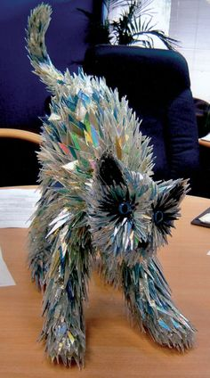 Animal sculpture made from CD fragments