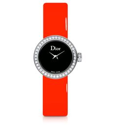 La Mini D de Dior, 19mm, quartz movement, steel case, bezel, crown and buckle set with diamonds, black mother-of-pearl dial, sapphire crystal glass, fluorescent orange patent leather strap and extra strap in black patent calfskin. Discover more on www.dior.com