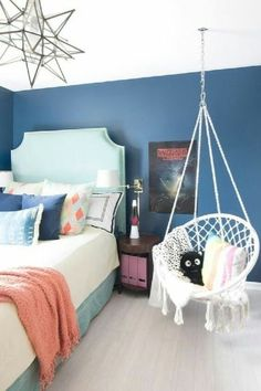 Fun teenage girl bedroom with dark blue walls stranger things poster turquoise headboard macrame hanging chair . Teenage Girl Bedroom Designs, Teenage Girl Bedrooms, Small Teen Bedrooms, Small Teen Room, Teen Rooms, Small Room Bedroom, Trendy Bedroom, Diy Bedroom, Bedroom Diy Teenager