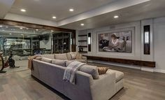basement home theater with workout gym