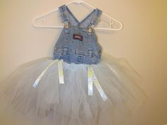 Learn How to Make a Jean Tutu Dress  Making a tutu dress is easier than you may think... In this picture a tutu skirt is attached to a jean bodice... This page has more ideas...