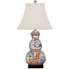 Porcelain Chinoiserie Square Gourd Table Lamp Chic porcelain chinoiserie table lamp with a modern gently curved square shape. Available in several beautiful colors and patterns to complement your decor. 150 watts max, 3 way medium base socket. UL Listed