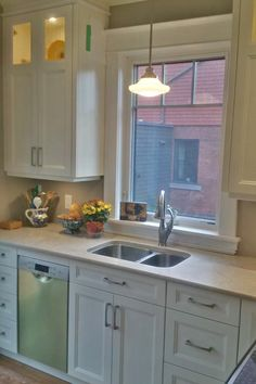 White Chocolate Cabinets With White Caesar Stone Counter, Under Mount Sink  And 18 Inch Bosch