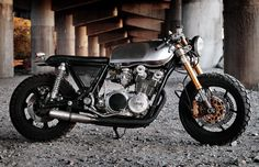 YAMAHA XS750 '78 SPECIAL by CLASSIFIED MOTO  [...this antique triple has one of the most devilish exhaust notes ever. Jetted with pods and custom 3-into-1 straight pipe, it's got power for days.     [Technically a Yamasaki, the front end was snagged from an '05 Kawasaki ZX6R (Ninja 636) which dramatically changes the stance and attitude of the beast. Stockton's bike was the first to incorporate the perforated metal side covers that let you get a hint of what's behind them...]