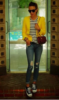 Neon jacket, distressed jeans, and converse sneakers