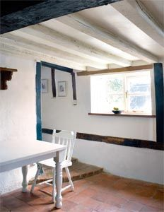 Brighten up your space by repainting ceiling beams a lighter colour