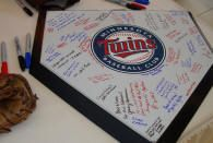 home plate guestbook is a great idea, maybe paired with a custom baseball bat