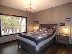 Master bedroom with 5 light chandelier.