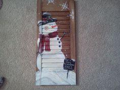 snowman painting on shutter