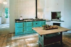 antique turquoise stove on white
