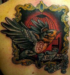 Dark tattoo with bird