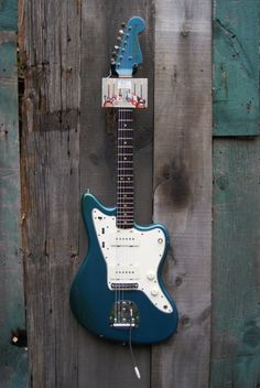 Fender announced the Jazzmaster at the 1958 NAMM show as a high-end jazz guitar with an array of innovative features and sleek sports-car inspired curves. Fender Electric Guitar, Fender Guitars, Jazz Guitar, Guitar Amp, J Mascis, Lake Placid Blue, Jazz Players, Namm Show, Elvis Costello