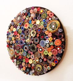 clock from recycled magazine pages coiled and glued onto record.