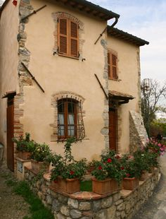 Tuscan Cottage ~ Maybe adding some rustic stones to corner edges would make the exterior stucco not so bland Colors to consider!