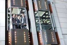 Out of Office: Trapped in an Elevator With 11 People – A Powerful . Glass Elevator, Atrium, Google Search, People, Camera, People Illustration, Folk