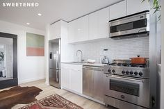 Clinton Hill Co-op Kitchen Renovation features high-end appliances: Bertazzoni range, Bosch dishwasher, and Fisher & Paykel fridge.