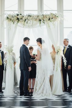 Neutral flowers and white linens adorn this elegant chuppah {G.Chapin Studios}