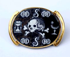 A 17th century hair slide in gold and enamel. This is a very rare example of memento mori