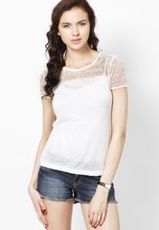 Highlight your feminine charm and make a cool fashion statement by wearing this off-white coloured top by ONLY. Styled with lace detailing, it will look great when clubbed with a pair of hot pants or boxer shorts.