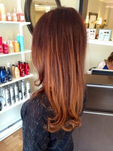 red/brown base with copper and golden balayage highlights. beautiful long red to copper hair