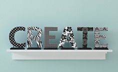 Cover store-bought cardboard or wood letters with patterned paper.