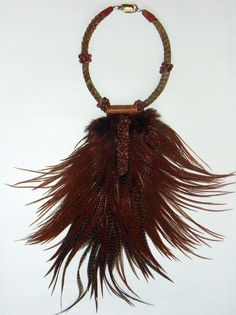 Necklace | Anne-Cécile Mesplet ~  Colliers d'Ailleurs/ Necklaces from Elsewhere.  Feathers and snake vertebrae.