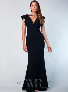 Black Ruby Gown. A beautiful gown by Love Honor. A v-neck style featuring frill sleeves and bow tie on the neck. #weddinginspo #formal