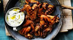 Neil Perry's smoky chicken wings with goat's curd dressing are a good way to get a party started!