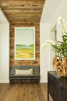 the focal point of the front entry is this continuous  wood wall that flows into the ceiling